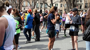 Marathon runners react after the incident