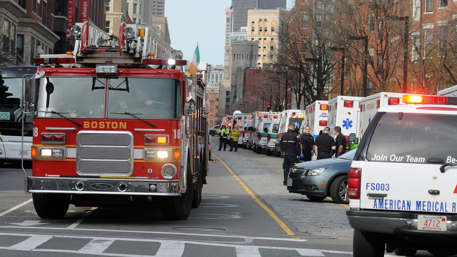 A long line of ambulances wait in a staging area after the explosions