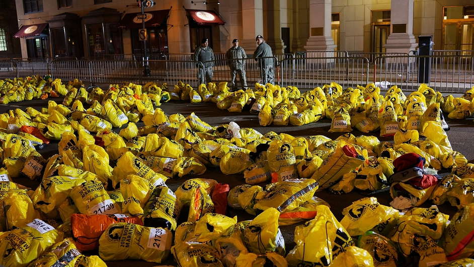 Unclaimed finish line bags are viewed near the scene in Boston