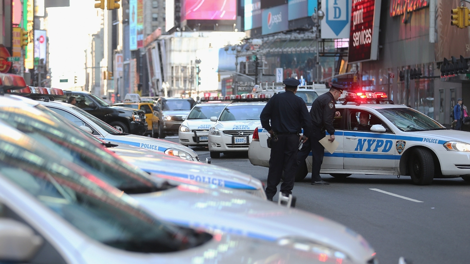 Policemen man their post at New York's Times Square after security was boosted following the Boston blasts