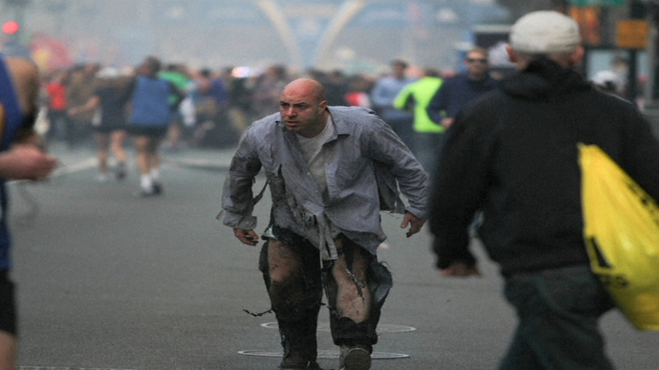 A man caught up in the blast walks through the streets in Boston (Pic: Kenshin Okubo, Boston Daily Free Press)