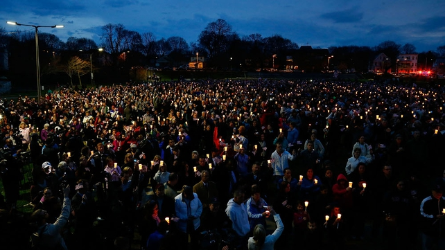 People gather with candles during a vigil for Martin Richard