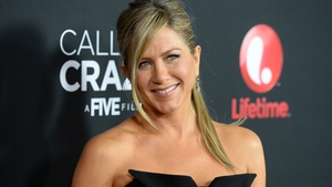 """Aniston - """"I usually shape the hair around my face with my fingers - just twist it and then refine it with a brush and let it air-dry"""""""