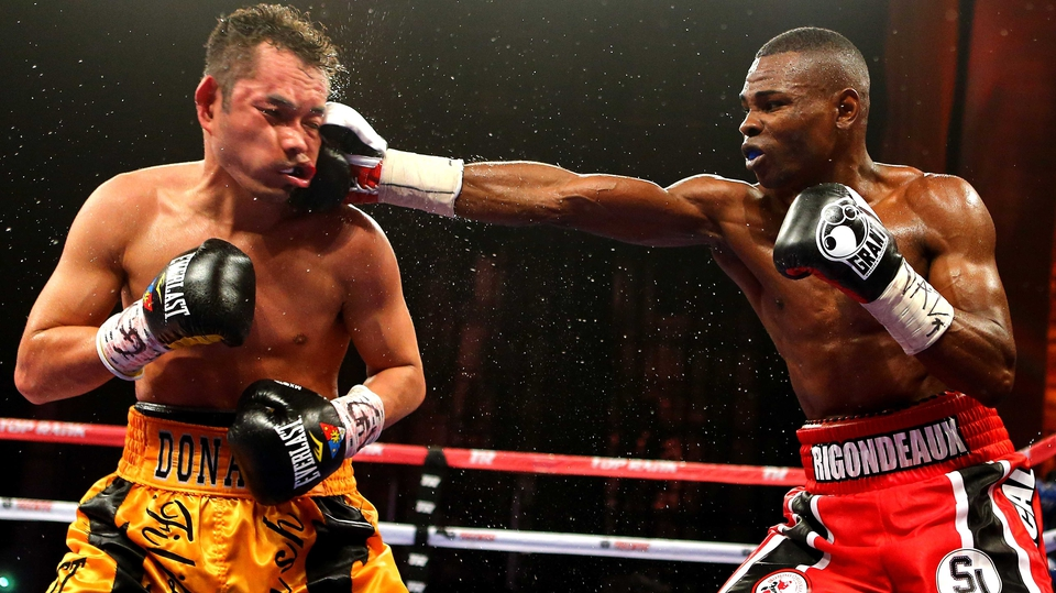 Guillermo Rigondeaux lands a punishing jab on Nonito Donaire during their WBO/WBA junior featherweight title unification bout at Radio City Music Hall in New York City