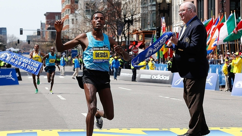 The calm before the storm - Desisa Benti of Ethiopia crosses the finish line to win the 117th Boston Marathon
