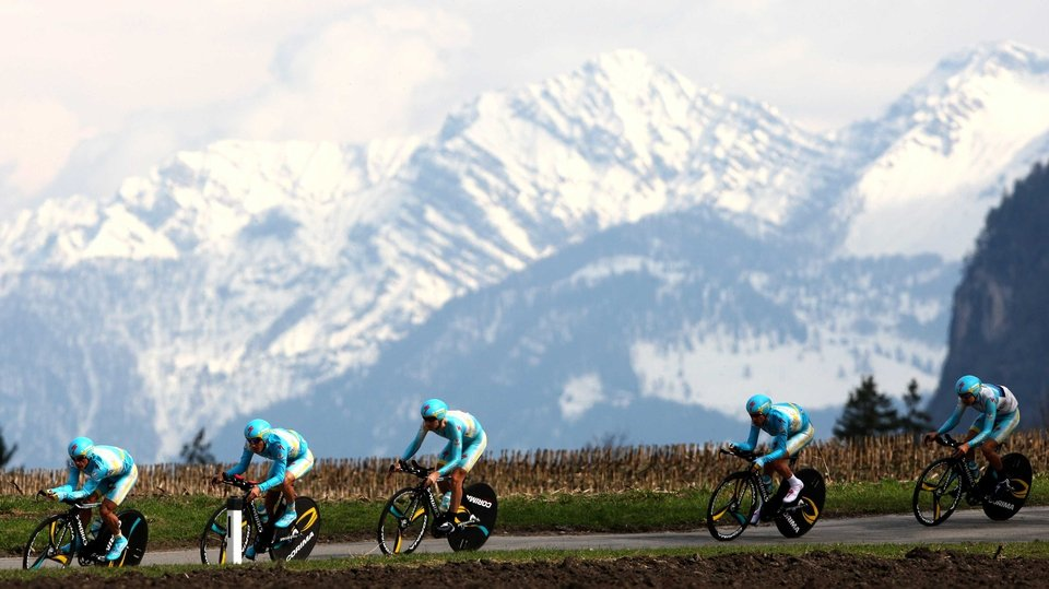 Cyclists of Astana Pro Team have no time to take in the amazing backdrop during the Team Time Trial at the Giro del Trentino in Lienz