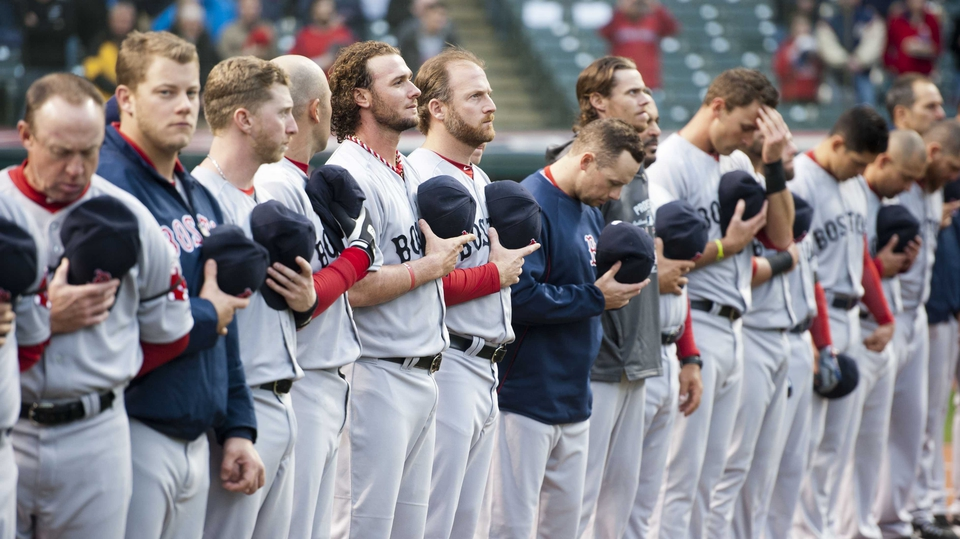 Boston Red Sox players observe a minute's silence prior to the start of their match against the Cleveland Indians at Progressive Field in Cleveland, Ohio