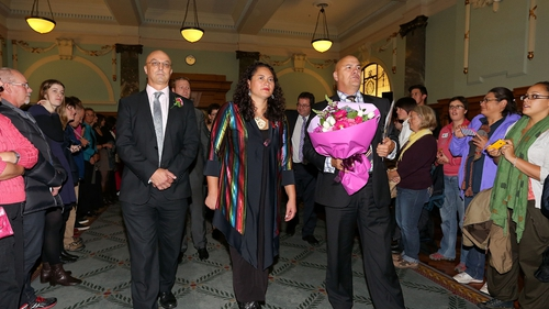 MPs Kevin Hague, Louisa Wall and Tau Henare are greeted by supporters after the vote