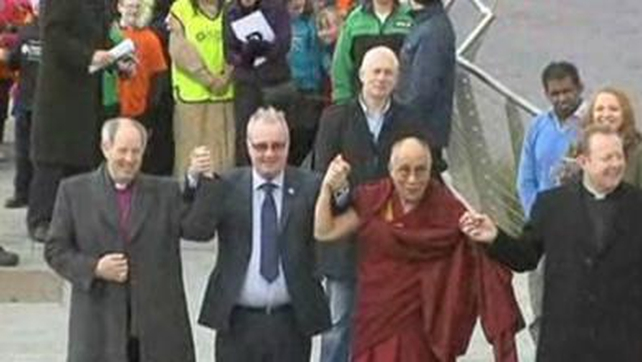 The Dalai Lama crossed the peace bridge linking the mainly Catholic west side of the river with the mainly Protestant east side