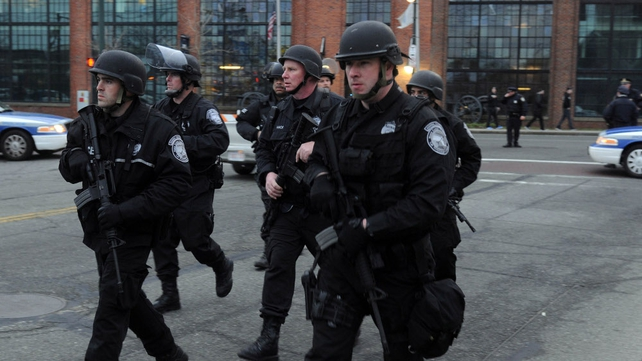 Police say a 19-year-old college student wanted in the Boston  bombings is in custody after a massive manhunt
