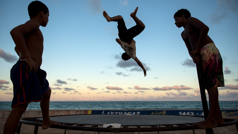 Children play on a trampoline on the beach in Recife in the state of Pernambuco in Brazil