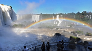 Tourists look at the Iguazu Falls from the Brazilian side of the Iguazu National Park, which is shared with Argentina