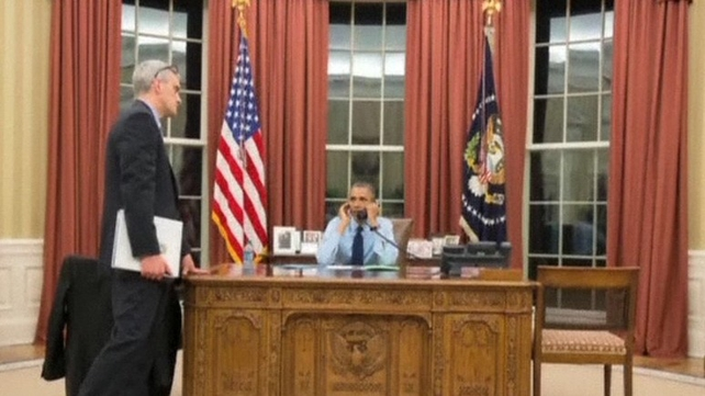 The White House released an image of President Barack Obama being briefed on the latest developments