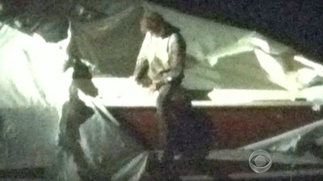 A CBS image shows Dzhokhar Tsarnaev in a boat in the back garden of a house in Watertown