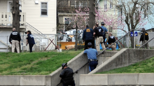Armed police conducted house-to-house searches in Watertown
