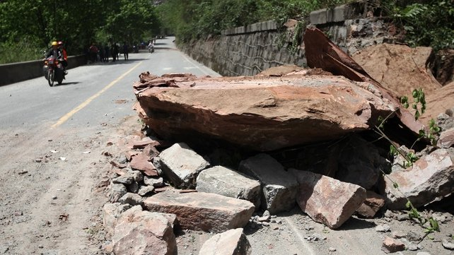 Huge rocks lie on a road after the earthquake