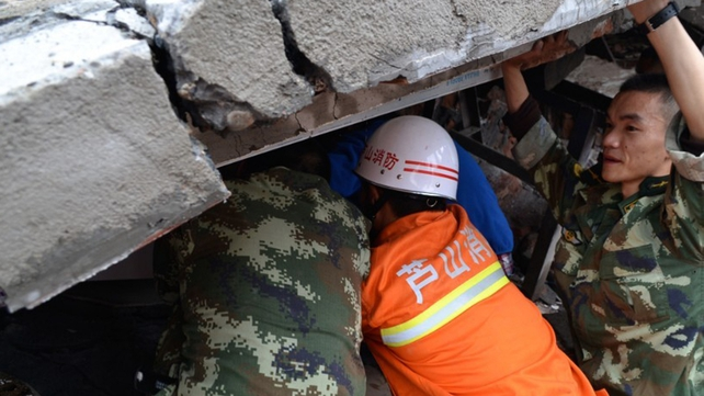 Rescuers are struggling to reach survivors trapped under collapsed buildings