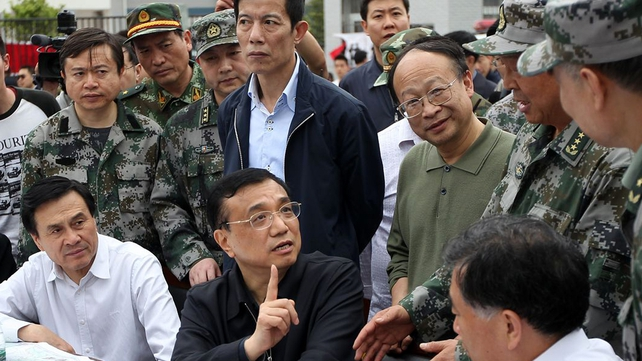 Chinese Prime Minister Li Keqiang (seated centre) is in the area to oversee rescue efforts