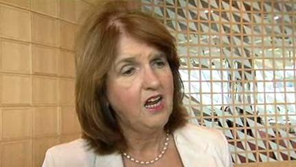 Joan Burton said it would be preferable if Eamon Gilmore was able to work full-time in a ministry at home