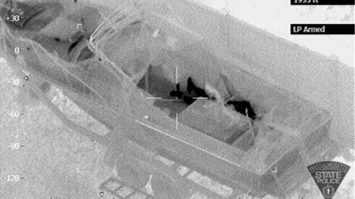 Police released an thermal image of Mr Tsarnaev lying in the boat in Watertown