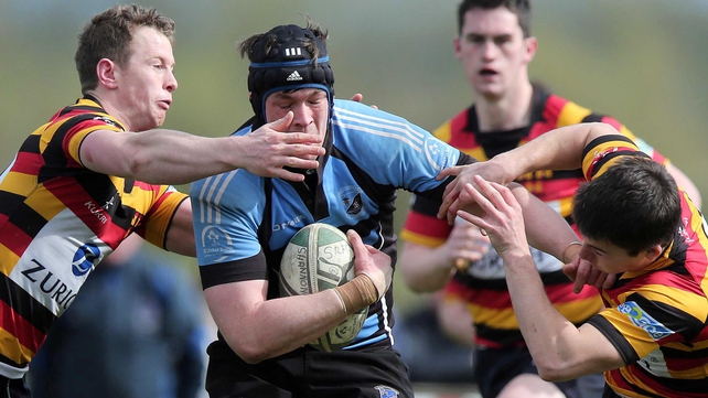 Shannon's Fergal Walsh is tackled by Matt Healy and Tom Kiersey of Lansdowne