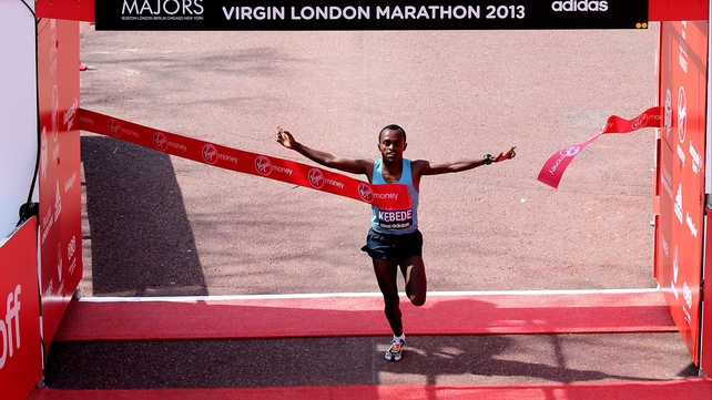 Tsegaye Kebede crosses the finish line