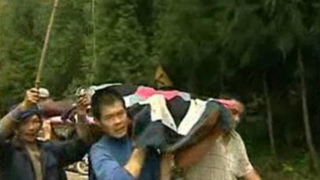 Rescuers hiked into Baoxing county after its roads were cut off and reached it overnight