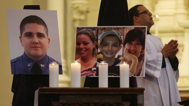 Images of the three bomb victims, and the MIT police officer shot dead during the week, are displayed in church