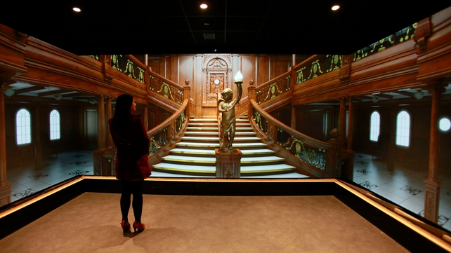 A changing electronic display is seen of the main staircase aboard the Titanic at the visitor centre