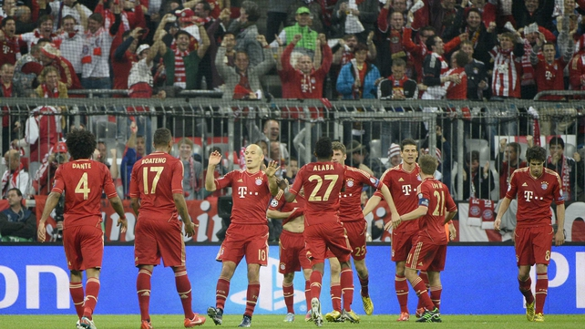 Bayern Munich players celebrate their opening goal at the Allianz Arena