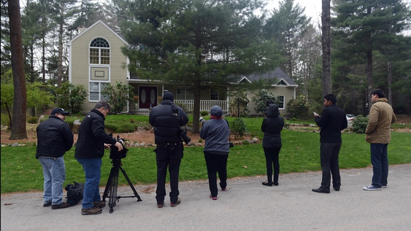 News media wait outside the home of Warren and Judith Russell, where their daughter Katherine Russell, the widow of Tamerlan Tsarnaev, is staying