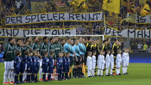 Borussia Dortmund and Real Madrid players line up ahead of the match