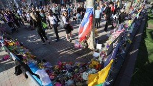 People gather at a makeshift memorial on Boston's Copley Square, near the scene of the bombings