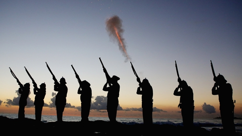 Members of the Albert Battery shoot a volley of fire during the ANZAC dawn service at Currumbin Surf Life Saving Club on Australia's Gold Coast