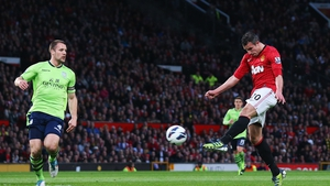 Robin van Persie of Manchester United scores his team's second goal during the Barclays Premier League match between Manchester United and Aston Villa