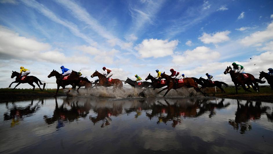 Runners make their way through Joe's Water Splash at Punchestown racecourse