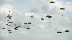 Soldiers from the Parachute Regiment of the British army parachute from an aeroplane in Stranraer, Scotland
