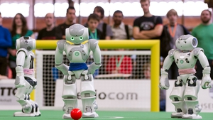 Two teams of robots play against each other in at the 2013 RoboCup German Open tournament in Magdeburg, Germany