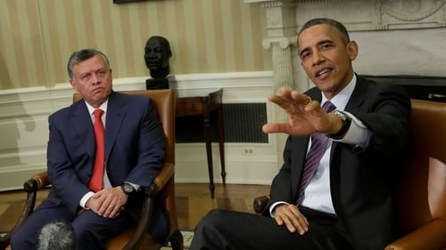 US President Barack Obama (R) speaks to the media with King Abdullah II of Jordan (L) before holding a bilateral meeting at the White House