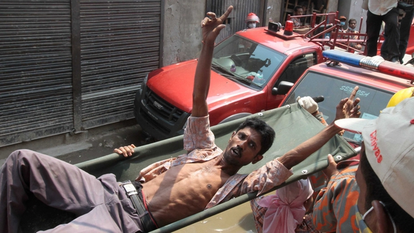 A Bangladeshi survivor reacts after he was recovered, 60 hours after the collapse