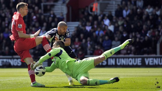 Ben Foster dives low to prevent Southampton's Morgan Schneiderlin