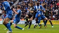 Spurs battle to save point at Wigan