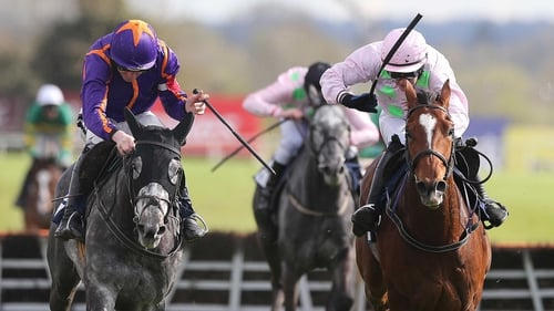 Blood Cotil (r) makes his debut over fences on Saturday