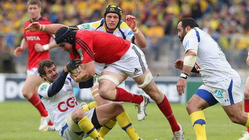 Tommy O'Donnell of Munster is tackled by Brock James (left), Julien Bonnaire (centre) and Davit Zirakashvili (right)