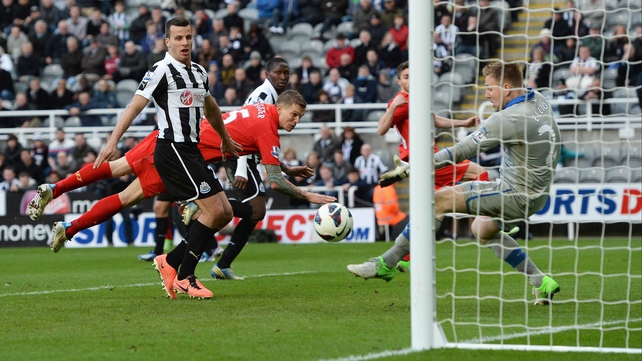 Jordan Henderson's free-kick skips past the dive of Daniel Agger and into the Newcastle net