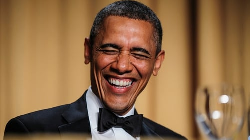 US President Barack Obama reacts to a joke told by comedian Conan O'Brien during the White House Correspondents' Association Dinner