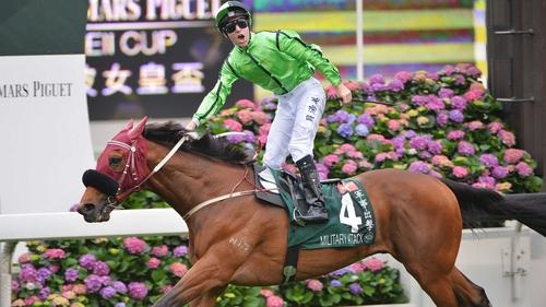 Jockey Tommy Berry celebrates aboard winner Military Attack