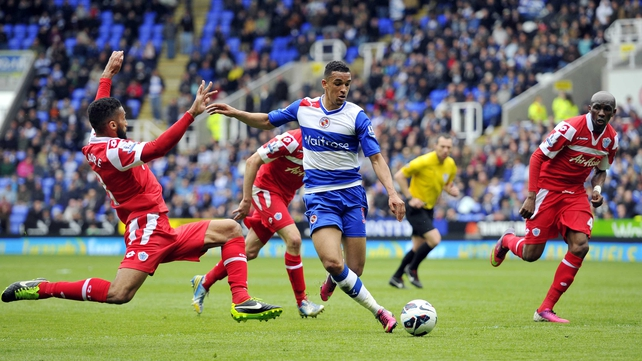 Reading's Nick Blackman unleashes a shot as Queens Park Rangers' Senegalese defender Armand Traore tries to block the ball