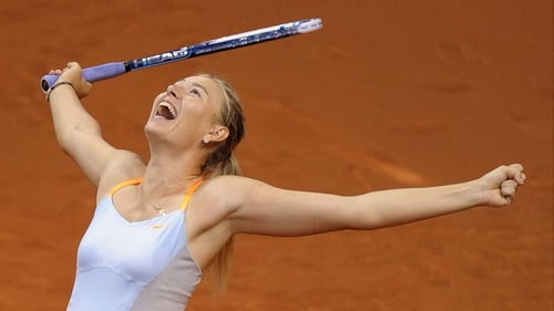 Maria Sharapova celebrates after defeating China's Li Na in the final match of the WTA Tennis Grand Prix in Stuttgart