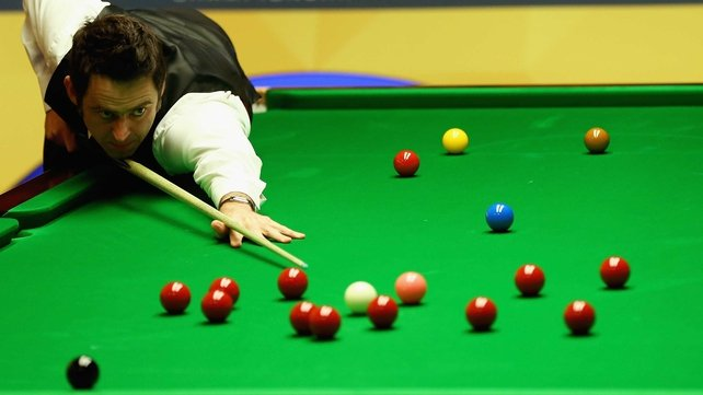 Ronnie O'Sullivan holds a 9-7 lead over Ali Carter
